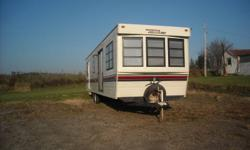 1992 HOLIDAIRE 38' WITH 2 POPOUTS IN EXCELLENT SHAPE ONE POPOUT REAR BEDROOM CLOSET WITH MIRRORS /SECOUND POPOUT IS IN THE DINNING ROOM /FULL LIVING ROOM/ LARGE KITCHEN AREA / LARGE REAR BRDROOM / FULL 3 PIECE BATH/ A/C UNIT / FULL HEATING SYSTEM