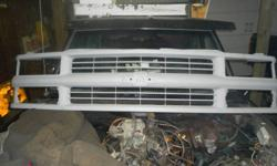1994 full size pickup truck grill and its paintable its all primer and it doesent have the bow tie with it 50 bucks firm