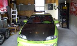 1995-1999 Chevy Cavalier carbon fiber hood Nice shape.. we bought a new hood  : ) Asking $300 cash for it.. no trades, sorry (613) 767 0787 Last picture is the new hood I bought