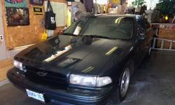 Make Chevrolet Model Impala Year 1995 Colour Green kms 214000 Trans Automatic The 1995 Chevrolet Impala SS is a perfect blend between sporty and functional. This sporty vehicle is in great condition with 214,000 km. The Impala boasts a comfortable and