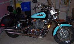 LOTS of UPGRADES ! This bike has been babied and paint is scratch free with new tires last fall, hard saddle bags,  The bike runs and sounds awsome with new Jardine exhaust to get that extra rumble. (Honda reliability) and ugraded K&N stage 1 jet kit.