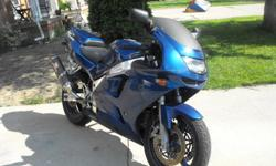 I'm selling my Kawasaki Ninja for $2000. It was just painted blue metallic and safetied in June of this year. The bike will come with a helmet and jacket as well. Email me with any questions.