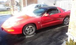 1995 Pontiac Firebird (red) as is. T-tops. V6. Starter, alternator, exhaust, suspension, and brakes replaced in last 18 months. Great parts car or project.  $700 OBO