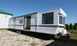 FULL HOUSE TYPE FRIDGE 3 BURNER RANGE W/OVEN MICROWAVE DUCTED A/C DUCTED FLOOR HEAT FRONT BEDROOM REAR 3 BUNKROOM 2 TIP OUTS AWNING PATIO DOOR LOTS OF STORAGE   RENAUD RV & POWERSPORT SALES 2558 COUNTY RD 20, HARROW, ON N0R 1G0 519-738-6222 OR TOLL FREE