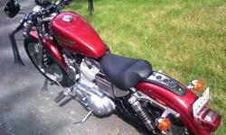 Nice candy red HD Sportster, Lady Driven since new, over $5,000 in HD accessories including custom seat, smoked windshield, forward controls, straight pipes, stage 1 engine modification and lowering kit. All original parts included as well. Will accept