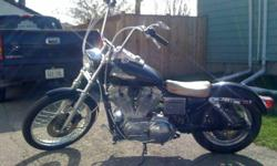 Selling my 98 Sportster 21inch spoked front wheel Stainless braided cables 18 inch ape hanger bars Fat Bob gas tank with gauge cluster and ignition on tank Arlen Ness mirrors Radius bent exhaust pipes Lowered 2 inches in the back Forward controls Also