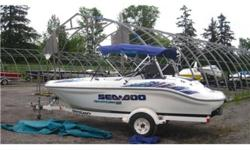 This Seadoo is exceptionally clean. It is powered by Bombardier twin Rotax engines, has a full mooring cover, full bimini and sits on a Shorland'r trailer. This boat just came in on a trade and will not last long.