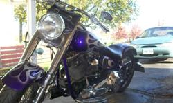 custom built fatboy  ,  99 mid usa frame  ,  s&s motor , avon tires  front & back front is brand new , phantom pad pasenger pad , lots of chrome  was a fresh build  in 2008 , slight paint damage around gas caps , runs great , good solid bike , will throw
