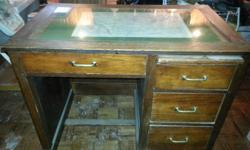 This is a mid 19th century desk, crafted by hand, glass top map desk, slide out file draw, 3 additional file drawers, very good condition for its age. $1200.00obo. Please email or call if you have any questions