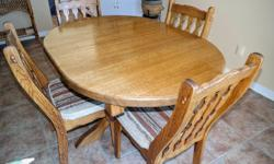 """Rare Solid Oak.Won't last long. Solid 1 1/2"""" thick solid Oak Dining room table and 4 chairs. Chairs have cushions. Great condition. No gauges or deep scratches. Includes 18"""" extension."""