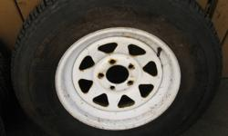 TIRE IS BRAND NEW. RIM IS USED. 905-971-0861 MARGARET AVE. STONEY CREEK.