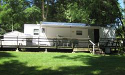 1 Bedroom (queen,in the rear). Sleeps 6. Large front window. Patio door and exterior door in the bedroom. 2 tip-outs. Full size fridge, microwave, hot water heater, furnace, a/c. Everything in working order. No leaks. Rubber roof. Awning. 50ft deck. 10 x