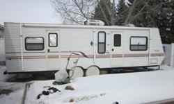 2000 Jayco 29 foot travel trailer with single slide. Rear bedroom, front kitchen, very clean unit. $9800.00, for more information phone or email.