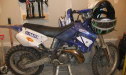 I have a 2000 yz250 bondi motor never been rebuit or raced , new tires. Full new exuast. bike is very very fast and motor runs very very strong. starts first kick Every time,have manual, Scares me eveytime I get on it. Have size 9 boots blue, helment,