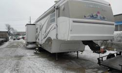 2001 Cedar Creek 38 foot 5th wheel trailer 3 pop outs solar panel up grades propane generator fire place plumed for washing machine first 12999 takes it sacrifice at this price