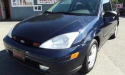 Make Ford Model Focus Year 2001 Colour Twilight Blue Metallic kms 151000 Trans Automatic Drivetrain: 4 Cyl. - 2.0L - Automatic - Front Drive - 151,000kms. Options : Air Conditioning - Alloy Wheels - AM/FM Stereo - Anti-Lock Brakes - Aux. Power Outlet -
