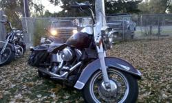 Heritage Softail Classic for sale , excellent condition , well cared for , very good rubber , always used Amzoil synthetic oils . Custom 2 into 1 long flame tip exhaust . 88 cube twin cam engine , Nice big saddle bags and quick detach windsheild . $8500