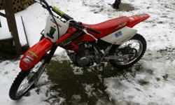 Hello.   Iam looking to sell my 2001 Honda XR 100cc.   Reason for selling is Iam too busy with family life to ride it.   It is red and black. Recently , right before winter I had installed a new fmf powercore 4 exhaust, a new chain, brakes, sprockets and