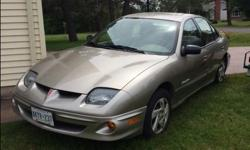 Make Pontiac Model Sunfire Year 2001 Colour Silver kms 96320 Trans Automatic 2001 Pontiac Sunfire 4 door 96320 Km. selling as is exterior has very little rust, was oil guarded on a regular bases, interior is very clean. Vehicle inspection report