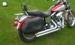 Dyna LowRider, Real Red/Silver pearl, stage one, performance ignition and wires, currently set up for short person, with pull back handle bars, Kuryakin grips and mirrors, and mid controls. Security, wire wheels, HD bolt on saddle bags, HD quick release
