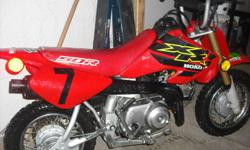 Great bike, 4 stroke 3 speed no clutch. New back tire, chain, front brake cable and air filter. Regular maintenace done. Reason for selling my son is moving to a bigger bike.
