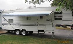 2002 Keystone Hornet 28.5' Fifth Wheel Trailer   28.5' in length with a 12' slide out 16' awning Queen size bed Two bunk beds Fridge (propane and A/C) Stove (propane) Microwave Pantry Hot water heater (propane) Forced air furnace (propane) Air
