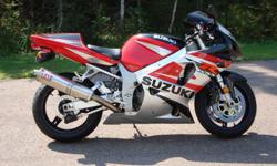 2002 Suzuki GSX-R 750, has 26000 km on it, lowering links installed, Yoshi slip-on, solo seat, have all original parts as well, in excellent condition, inspected until this summer, asking $5300.