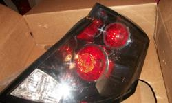 Set of black tail lights, used for only 6 months, in MINT condition. Bought on ebay for over $140.00 for set. Willing to part with them for $100.00 or make me an offer. Great deal! Great X-mas Gift! Still in original box. Will only fit the Sedan style