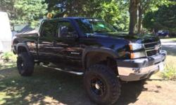 """Make Chevrolet Model Silverado Year 2003 Colour Black kms 3300000 For sale by owner is a 2003 Chevrolet Silverado in good condition with 330,000 km. It Comes equipped with a 6"""" Rough Country Lift, and lots of new additions including a new exhaust, new"""