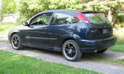 """2003 ford focus zx3 2.0l fwd auto 130+ horsepower  2 door dark metallic blue with rear fold down seats  car has17"""" rims with maxii tires, Sony explode deck compatible with cd,usb, ,Ipod  also has K&N air filter G Force performance chip, voltage stabilizer"""