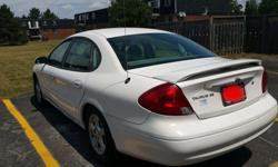 Make Ford Model Taurus Year 2003 Colour white kms 180300 Never has any accident. No smoke and pets. It has 18030 km on it. Still runs greatly. Power seat adjustment & pedal elevation , power mirror, cruise, The car has been regularly maintained and done