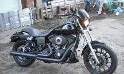 """'03 FXDX Dyna Sport. Adjustable front and rear shocke,triple disc brakes,vance & hines pro pipe,forward controls,6"""" drag bars,P.M grips,New Avon Venoms. Bike has 9600 original km's with no accidents.I have 2 paint sets for this bike-the anniversary bar &"""