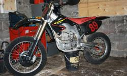 Awsome CRF 450 R bike presently set up for the ice. Have original plastic, spare rims and tires for the dirt. Properly built ice tires by George Jones with wraps. runs perfect, never had any engine work, original spark plug. Bike has been solely used for