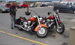 """2003 honda vtx 1300      BIKE ONLY HAS 17000KM ON IT  HAS 3""""VANCE AND HEINZE   BIG SHOT  STRAIGHT PIPES VERY LOUD  HAS ABOUT 8000 JUST IN ADD ONS    VERY CUSTOM   HAS SPOKED RIMS,   BRAIDED LINES  CUSTOM STICHED SEATS, UNDER TANK LIGHTING THAT LIGHTS UP"""