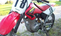 FoR SaLe 2003 Honda XR 100cc Dirt Bike In great cond. engine starts and runs good., 4 cycle, brakes good, 5spd, needs nothing, no damage, handle bars where replaced last year. ASKING $1600.oo or any fair offer will be considered. Best to call RyaN@ 905