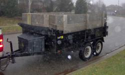 This is a 2003 JDJ 6'x10' dump trailer - black.  3500lb axles, tarp kit, Krown rust proofed since new. Hydrolic lift.  $3500.00 Call or email for more info.