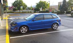 Make Mazda Colour Blue Trans Automatic kms 245000 Automatic full load blacked out windows
