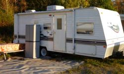Buy Now and I Will Store It Til Spring!   The Salem LE features a full queen size bed up (not one of those short RV queen beds) front and bunks in the back for the kids.  It's easy to tow and easy to maneuver...I originally purchased it to be towed with a