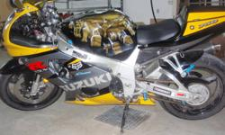 I am selling my 2003 gsx-r 750, It has a ton of extras on the bike. Which include: Custom painted gas tank Devil exhaust slip-on exhaust power comander K & N air filter cutom mirror yellow windscreen Brand New Front Tire blue foot pegs and rear spools