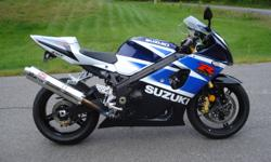 2003 GSX-R 1000 Blue and white, in excellent condition $4,800.  Yoshimura exhaust, ground effects, flush mount turn signals and fender eliminator.  Stock parts (exhaust and fender) included.