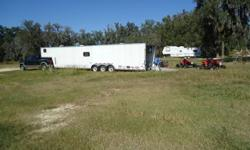 2004 24ft Tri axle toy hauler.  Will carry 4 quads or will fit car/truck. Trailer had a full steel frame. Has 20ft of garage with toolbox, work bench and storage cabinets. 22ft of living space has 2 piece bath, full size fridge, 4 burner stove/oven,
