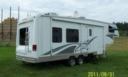 Model 2934 RL 1 large slide out, rear living room, hardwood floor, TV with roof satellite dish, outside radio speakers, central vacuum, outside window awnings, center support for large awning, 18ft ground mat, trailer hitch (rear) plus wiring, lighted