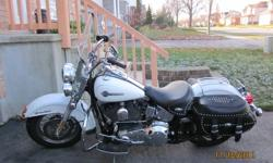 Softail Heritage Classic iridescent pearl white in showroom condition, 13,729 kms, original owner (mature lady),garage stored, never seen rain,screaming eagle pipes,engine guard, easy clutch, passenger seat included, pampered since new, complete with
