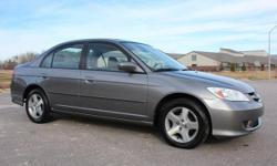 Make Honda Model Civic Year 2004 Trans Automatic kms 58210 2004 Honda Civic EX Sedan comes in a dark Gray Metallic with Gray cloth interior, looks and drives great with a new set of tires all the way around, great fuel economy with its 1.7L four cylinder