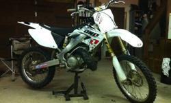2004 HONDA CR 250!! Super clean bike! Has new white plastics with one industries graffix kit! Aftermarket seat and Ballistics seatcover! Renthal Fat bar! New Renthal chain and sprockets! Fresh top end in the spring! IMS foot pegs! Landing Gear Suspension