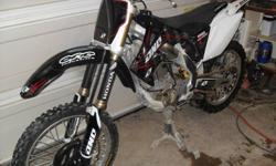 Awesome bike in excellent cond. Comes with(new this summer less that 5 rhs) oversize handlebars, front and rear tire, chain and sprokets, oversize pegs, plastic and graphics. Bike runs great, ready for spring. Some spare parts available. Please call