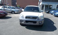 Make Hyundai Model Santa Fe Year 2004 Colour white kms 249000 Trans Automatic Automatic, AC, 4 Doors SUV, All wheel drive, 6 cylinders 2.7L engine very good in gas, power windows, power lock, power mirror, cruise control, CD player, leather, heated seats,