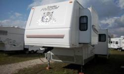 2004 - 30' - Prowler Regal 305RLDS - $15,995.00 - Rear living, double slide model. Sleeps up to 4. Front queen walk around bed. 14ft power slide with hide a bed sofa and free standing table and chairs. 3 burner stove top with oven & microwave. 2 way