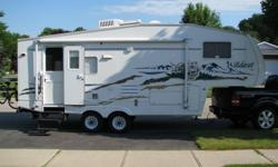 2005 25.5' Wildcat 5th Wheel made by Forest River, slide out, excellent condition, presently pulled by a F150, winterized, open concept design, large queen bed, all the comforts of home plus many included options, must be seen, $14000, ph. 519-753-4467.