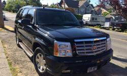 Make Cadillac Model Escalade Colour Black Trans Automatic kms 261000 2005 black Cadillac Escalade in great shape for sale. Has new front and back brakes and rotors. Tires are still in good shape. 3 rows of seating, 4 captains chairs all heated in first 2